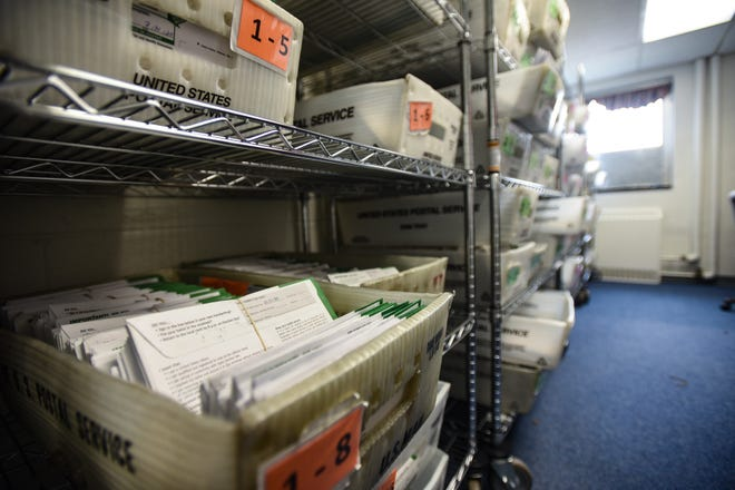 Boxes of absentee ballots seen Monday, Aug. 3, 2020, at the City Clerk's Office in Lansing.
