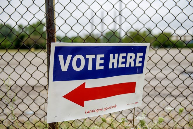 A sign alerts residents where to vote at the Lansing City Clerk's Election Unit on Monday, Aug. 3, 2020, in Lansing.