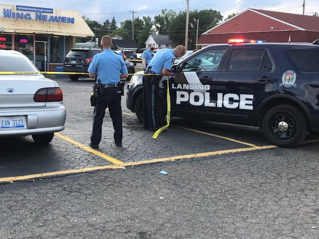 Lansing officers work at the scene of a shooting that left one man dead and another seriously injured on Monday, Aug. 3, 2020. The second man died Tuesday.