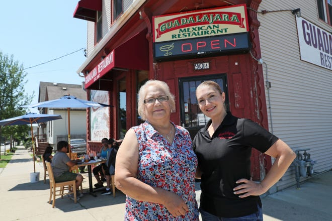 Genoveva Lozada, left, and her husband, Felipe, own Guadalajara Mexican restaurant at 901 S. 10th St. in Milwaukee. Her daughter, Fabiola Estrada, right, helps manage the business. At first, they remained open only for carry-out orders. Now they aretrying to navigate the economic fallout from the pandemic as they operate on reduced hours.