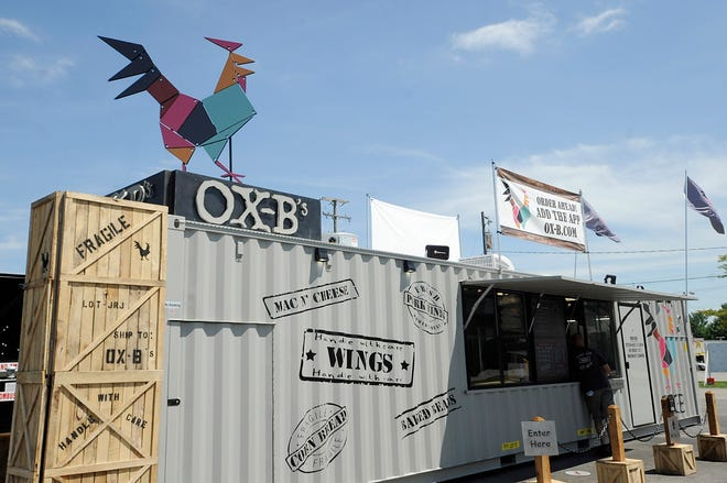 "Ox-B's, a ""food truck on steroids"", serving wings, mac and cheese, cornbread, waffle fries, and other dishes. The business recently opened its second location in the Pataskala Square parking lot just off Ohio 16 (Broad Street) in Pataskala."