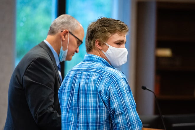Clayton Ellis stands at the podium during a plea hearing in front of St. Clair County Circuit Judge Cynthia Lane on Monday, Aug. 3, 2020. Ellis, 19, is charged with distributing or promotion of child sexually abusive material, using computers to commit a crime and three counts of possession of child sexually abusive material.