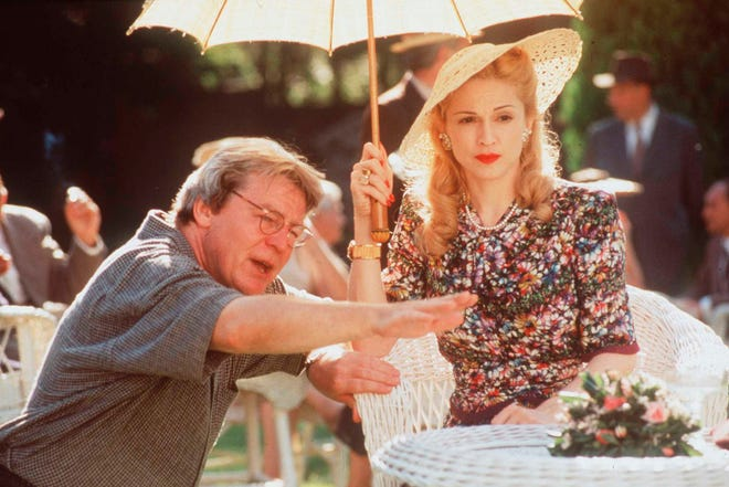 """Madonna and director Alan Parker on set for the movie """"Evita,"""" on Jan. 17, 1997. Parker died Friday at the age of 76."""