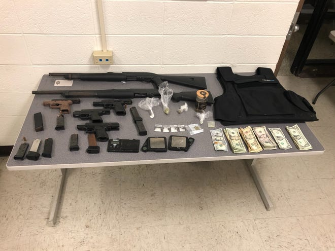 Richmond Police Department confiscated firearms, ammunition, body armor, cash and narcotics from a North 22nd Street residence.