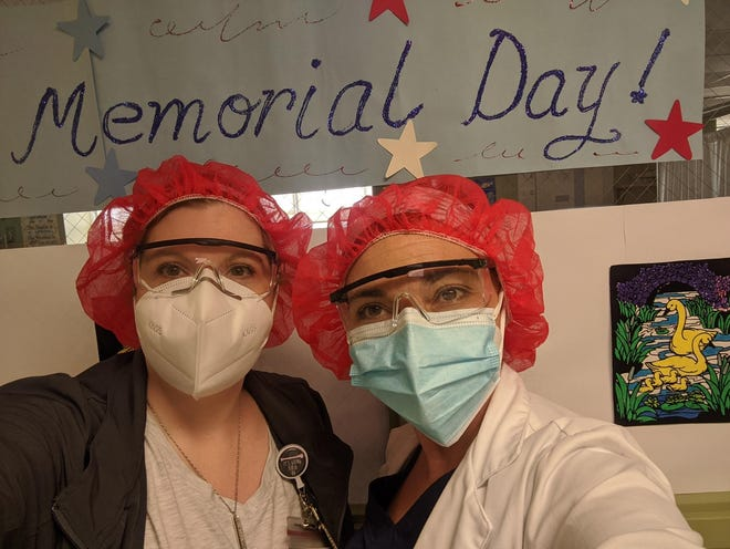 Nurse manager Jennifer Emmons (right) and another nurse try to bring a bit of festivity to Memorial Day at Bergen New Bridge Medical Center in New Jersey.