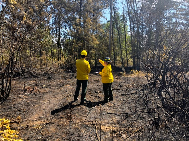 The fire at Fishermen's Bend Recreation Site burned about 2.5 acres and closed the park temporarily.