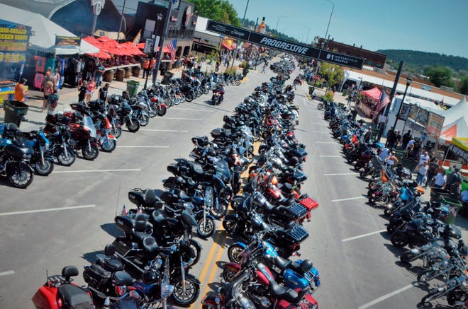 This Aug. 2, 2019 photo shows Main Street was filled with motorcycles in Sturgis, S.D. South Dakota, which has seen an uptick in coronavirus infections in recent weeks, is bracing to host hundreds of thousands of bikers for the 80th edition of the Sturgis Motorcycle Rally. More than 250,000 people are expected to attend the Aug. 7 to Aug. 16 rally in western South Dakota.