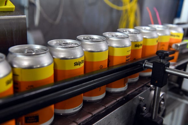 Cans of Skip Day, a specialty brew, move down an assembly line on Monday, August 3, at Fernson Brewery in Sioux Falls.