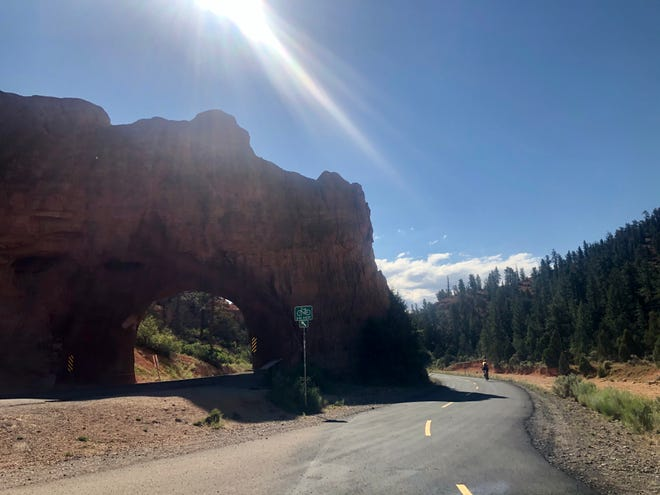 The Red Canyon Bike Trail passes by Red Canyon Arch on UT-12 on its way to Inspiration Point within Bryce Canyon National Park.