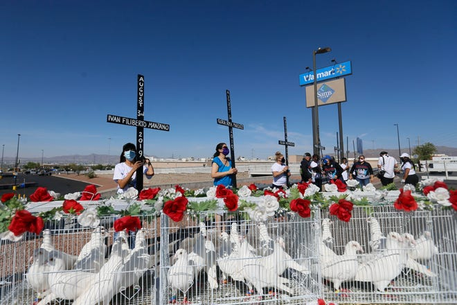 El Paso Firme and Border Network for Human Rights marched down Sunmount Drive toward the original Walmart memorial Monday, Aug. 3, 2020, in El Paso. A gunman opened fire at a Walmart in El Paso, killing 23 and injuring several others Aug. 3, 2019.