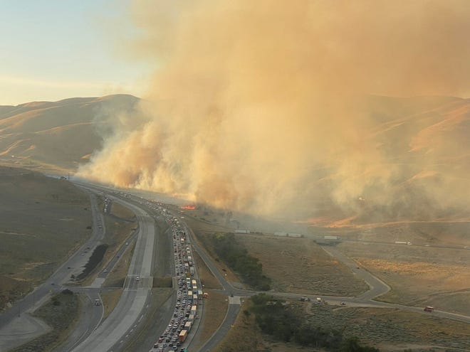 Traffic on northbound Interstate 5 near Gorman, along the Grapevine, was impacted Sunday night by a brush fire, authorities said, on Aug. 2, 2020. This photo was taken by a helicopter crew with the Los Angeles County Fire Department.