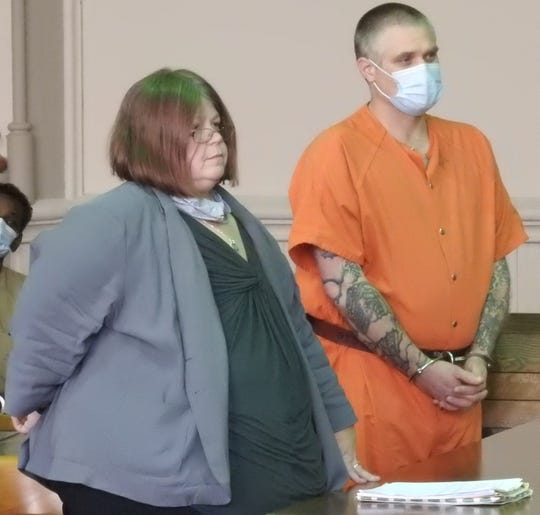 """Attorney Amy Otto with William """"Doug"""" Nottingham in Muskingum County Common Pleas Court. Nottingham entered guilty pleas to charges of breaking and entering, theft, and possession of a dangerous ordinance. He awaits sentencing from Judge Kelly Cottrill."""