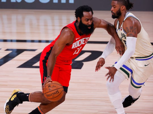 James Harden scored 24 points to help spark the Rockets to a late rally over the Bucks.