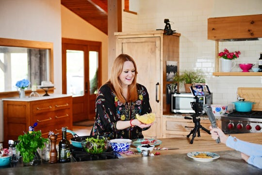 "Ree Drummond is filmed making a parmesan salad bowl, for an episode of ""The Pioneer Woman"" filmed with a smartphone."