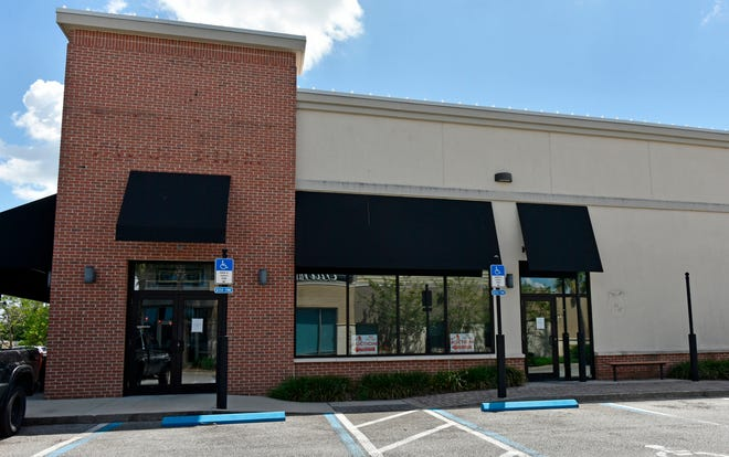 Pei Wei Asian Kitchen at The Markets at Town Center near St. Johns Town Center has closed abruptly and is auctioning off all its equipment. [Will Dickey/Florida Times-Union]