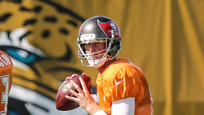 In a foreshadowing of his future, Jaguars quarterback Mike Glennon drops back to throw during a joint 2016 practice in Jacksonville when he was with the Tampa Bay Bucs. [Gary Lloyd McCullough/For the Times-Union]