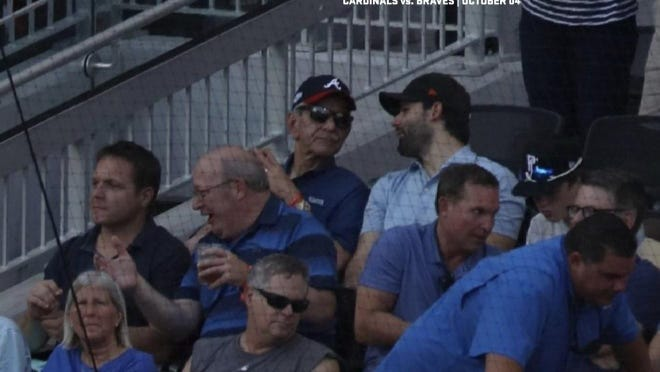 Lobbyists Sam Mousa and Tim Baker (pictured top from left) at an October 2019 Atlanta Braves game with JEA's now-fired CEO Aaron Zahn (left), Jacksonville City Council President Scott Wilson, Mayor Lenny Curry, and Curry's chief of staff Brian Hughes. Mousa and Baker's lobbying firm arranged the trip.