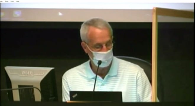 This screenshot from YouTube shows Board of Education Chairman Keys Fillauer with a mask at a Board of Education meeting Monday, Aug. 3.