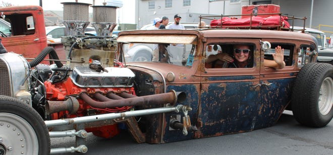 The Social Butterfly Kristi K. Higgins poses for a photo inside a '31 Chevrolet Independence Rat Rod owned by Junior Bratton of Matoaca at the Breakfast Cruise-in presented by the OBGCC and the Keystone Truck & Tractor Museum in Colonial Heights on Aug. 1, 2020.