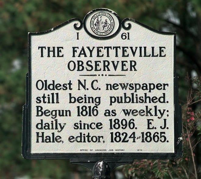File photo of the historical marker in front of The Fayetteville Observer offices.
