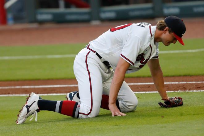 Atlanta Braves starting pitcher Mike Soroka (40) waits for assistance from the training staff after being injured in the third inning of a baseball game against the New York Mets Monday, Aug. 3, 2020, in Atlanta. Soroaka was helped to the dugout and replaced.