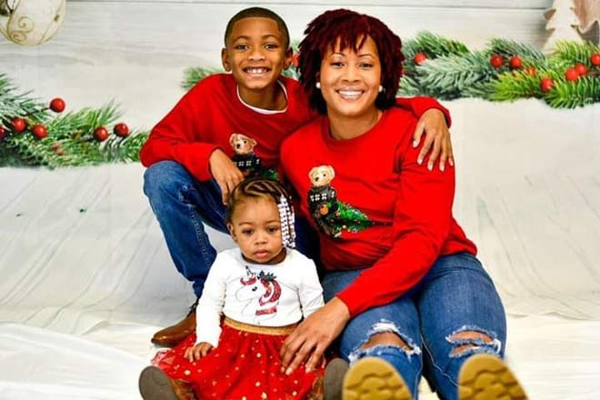 A photo taken at Christmas shows Kayla Kyle and her two children, Kaleb Billings and Rhyelle Rogers. [Contributed photo]