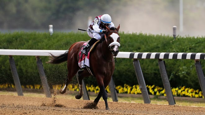 Tiz the Law (8), with jockey Manny Franco up, approaches the finish line on his way to win the 152nd running of the Belmont Stakes horse race, Saturday, June 20, 2020, in Elmont, N.Y.