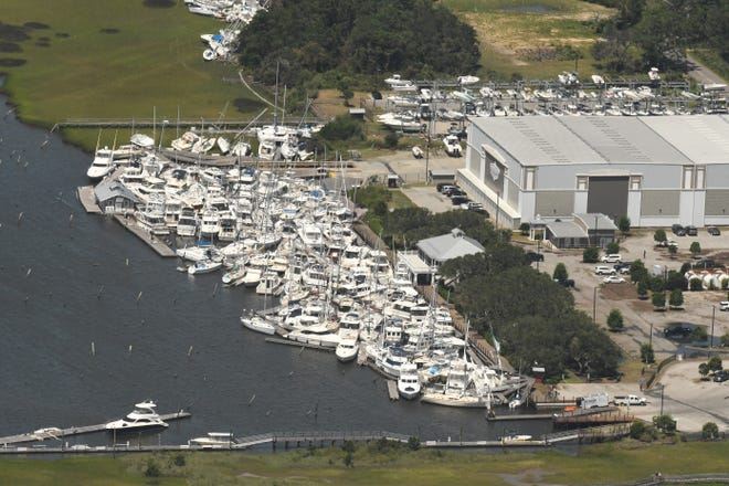 Boats are stacked on top of each other in the Southport Marina Tuesday Aug. 4, 2020 in Southport N.C. after Hurricane Isaias came ashore over night in Brunswick County as a category 1 hurricane.  [KEN BLEVINS/STARNEWS]