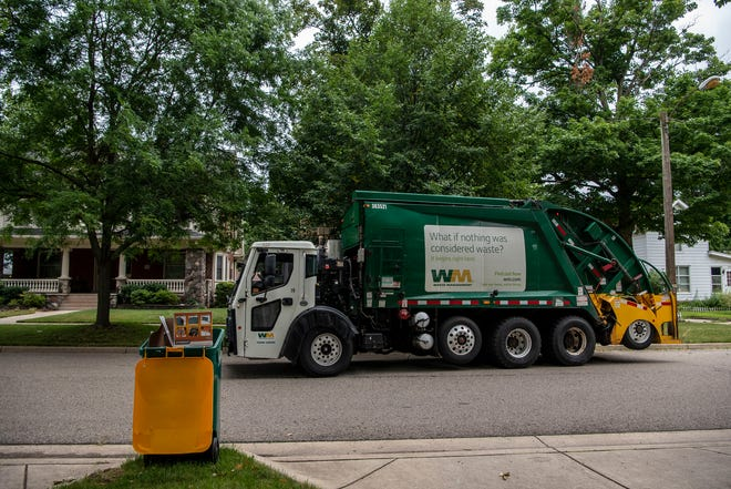 A Waste Management truck drives down Orchard Place on Tuesday, Aug. 4, 2020 in Battle Creek. Waste Management has contacted Battle Creek about a recycling contamination problem.