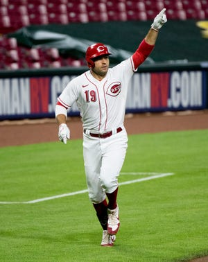 Cincinnati Reds first baseman Joey Votto (19) celebrates after hitting a two run home run in the sixth inning of the MLB game between the Cincinnati Reds and the Cleveland Indians at Great American Ball Park in Cincinnati on Monday, Aug. 3, 2020.