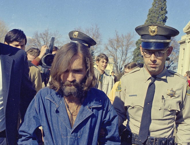 Charles Manson, who is linked to the Sharon Tate murders, is seen 1969.