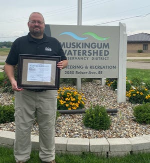 Scott Barnhart retired from the Muskigum Watershed Conservancy District after 31 years of service.