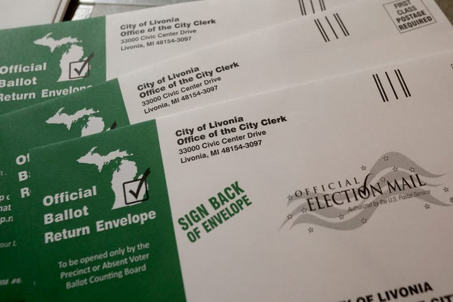 Envelopes that many Livonia residents had mailed to them to vote absentee at the Livonia City Hall complex in Livonia, Michigan on August 4, 2020