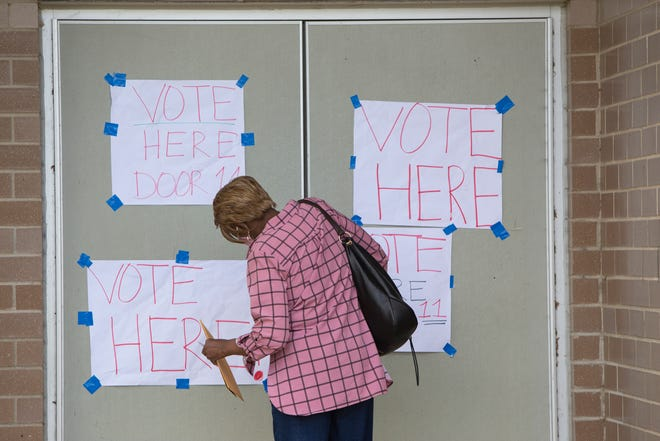 Shirley Moore of Detroit just received her absentee ballot in the mail but because she didn't have enough time to mail it back she brought it to her polling location to replace it by voting in person during the primaries on Aug. 4, 2020, in Detroit at the East English Village High School campus.