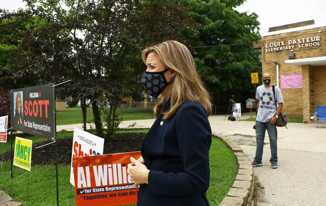 Secretary Jocelyn Benson visits a polling station inside Pasteur Elementary School in Detroit during the primary elections on Tuesday, August 4, 2020.