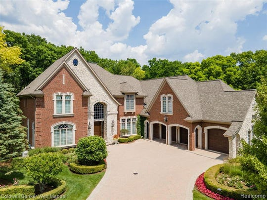 A Tuscan estate in Washington Township designed with over 12,000 square feet of living space features dramatic ceilings, hardwood and marble floors, motorized chandeliers, extra large windows, and custom artist details throughout.