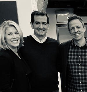 Jamie Samuelsen and wife Christy McDonald with Seth Meyers in 2019.