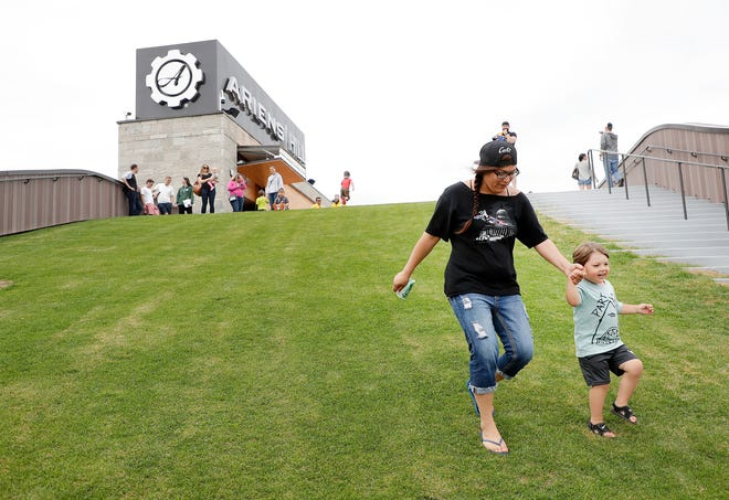 Families have fun playing on the grass of the Ariens Hill complex at the Titletown District Saturday, June 2, 2018, in Ashwaubenon, Wis.