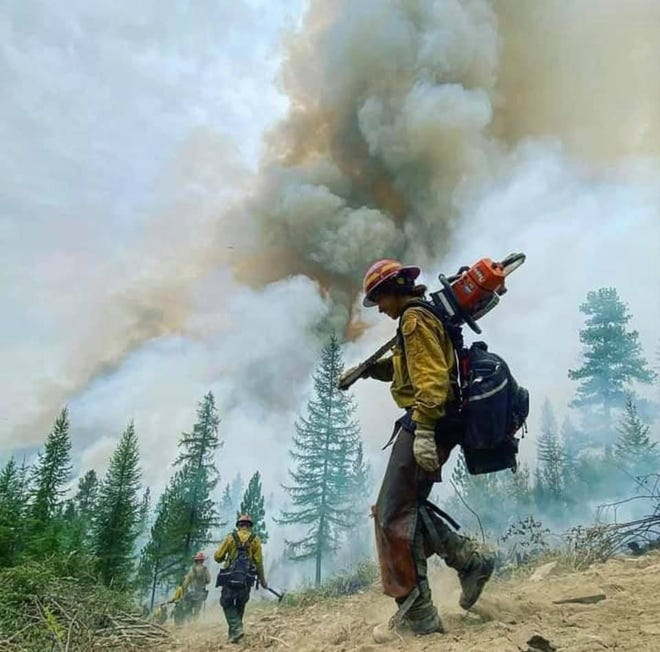 CSKT firefighter Regan Lilfeather hikes into the Magpie Rock Fire eight miles west of Dixon, Montana. The 3,600 acre blaze is now 62% contained.