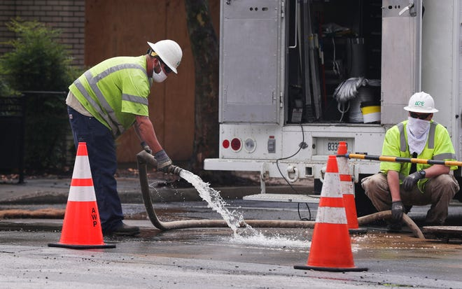 A crew tidies up the scene after controlling a 12 inch water main break at 2nd and Market on Aug. 4, 2020.