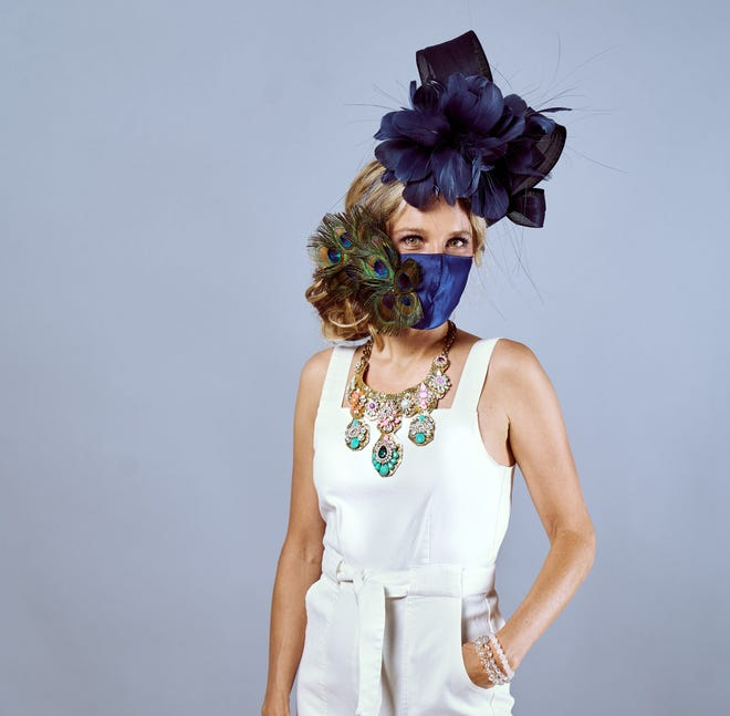 Kenzie Kapp models one of her fascinators with a matching face mask for Kentucky Derby 146.  You can reach Kenzie Kapp at her studio at  (502) 771-1286 or email her kenzie@kenziekapp.com.