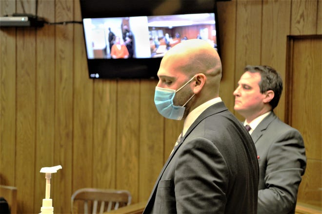 Attorney Adam Banks, foreground, addresses Magistrate Michael Bear on behalf of his client Miguel F. Gonzales, 19, Marion, during an arraignment hearing for Gonzales on Monday, Aug. 3, 2020, in Marion County Common Pleas Court. County Prosecutor Ray Grogan, right, listens as Banks speaks. Gonzales appeared at the hearing via video conference, upper left, from the Multi-County Correctional Center, where he is being held on $1 million bond. The Ratliff Law Office of Marion has been retained to represent Gonzales.