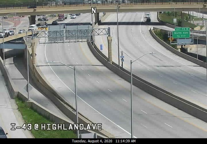 Marquette University police and the Milwaukee County Sheriff's Office shut down I-43 at Kilbourn Avenue Tuesday morning after an incident.