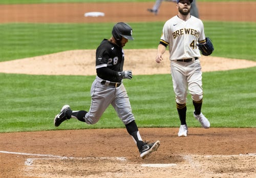 The White Sox's  Leury Garcia scores on a wild pitch thrown by Brewers relief pitcher David Phelps.