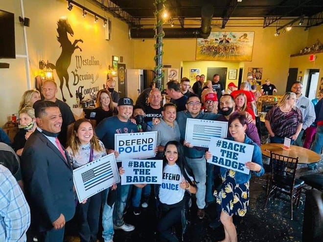 Milwaukee Police Chief Alfonso Morales, far left, drew criticisms online after photos of him at a West Allis bar with few people wearing masks began circulating on social media.