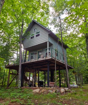 The Boulder Ridge Treehouse stands 12 feet above the ground and features a wrap-around deck for taking in the views of the surrounding forest in Bayfield County.