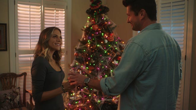 """Jana Kramer, left, and Wes Brown star in """"Christmas in Mississippi,"""" a past holiday offering on Lifetime. This year, the cable channel's holiday movies included an LGBTQ romance set in Milwaukee."""