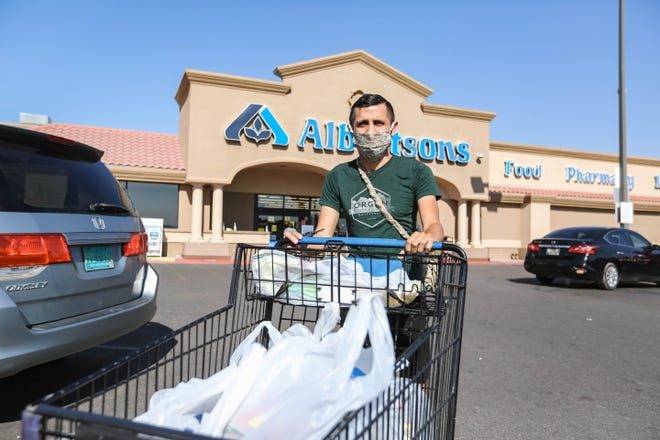 Arik Ruiz picks up food for an Instacart order from Albertsons in Las Cruces on Monday, August 4, 2020.