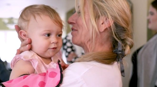 Mama's House volunteer Julie Orr says she loves taking care of babies while their mothers work to improve their lives.