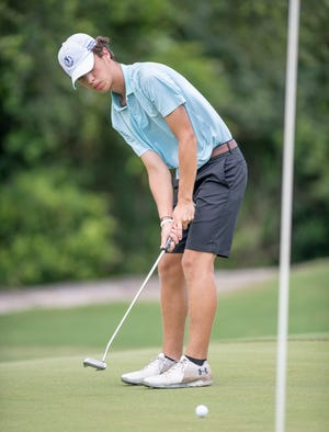 David Chavez putts during the A. Downing Gray Cup golf tournament at Pensacola Country Club in Pensacola on Tuesday, August 4, 2020.